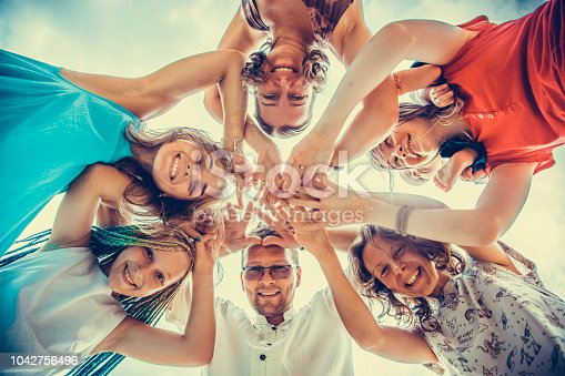 866758230istockphoto Group of people holding hands. Unity concept 1042756496