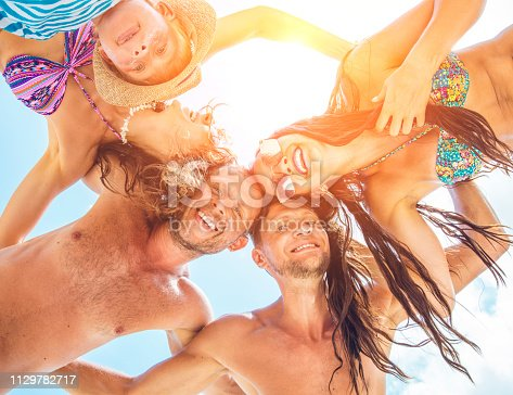 866758230istockphoto Group of people holding hands. Unity concept 1129782717