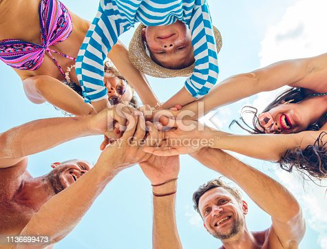 866758230istockphoto Group of people holding hands. Unity concept 1136699473