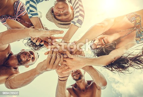 866758230istockphoto Group of people holding hands. Unity concept 969428502