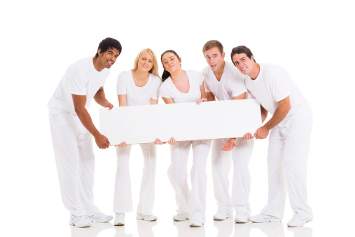 1166716628 istock photo group of people holding heavy billboard 477562371