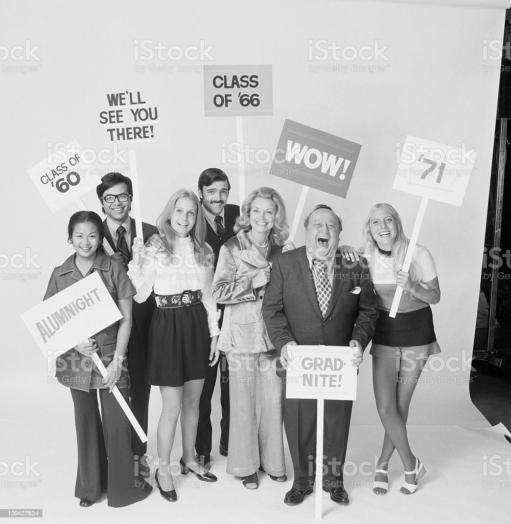 Group of people holding placards, smiling, portrait stock photo