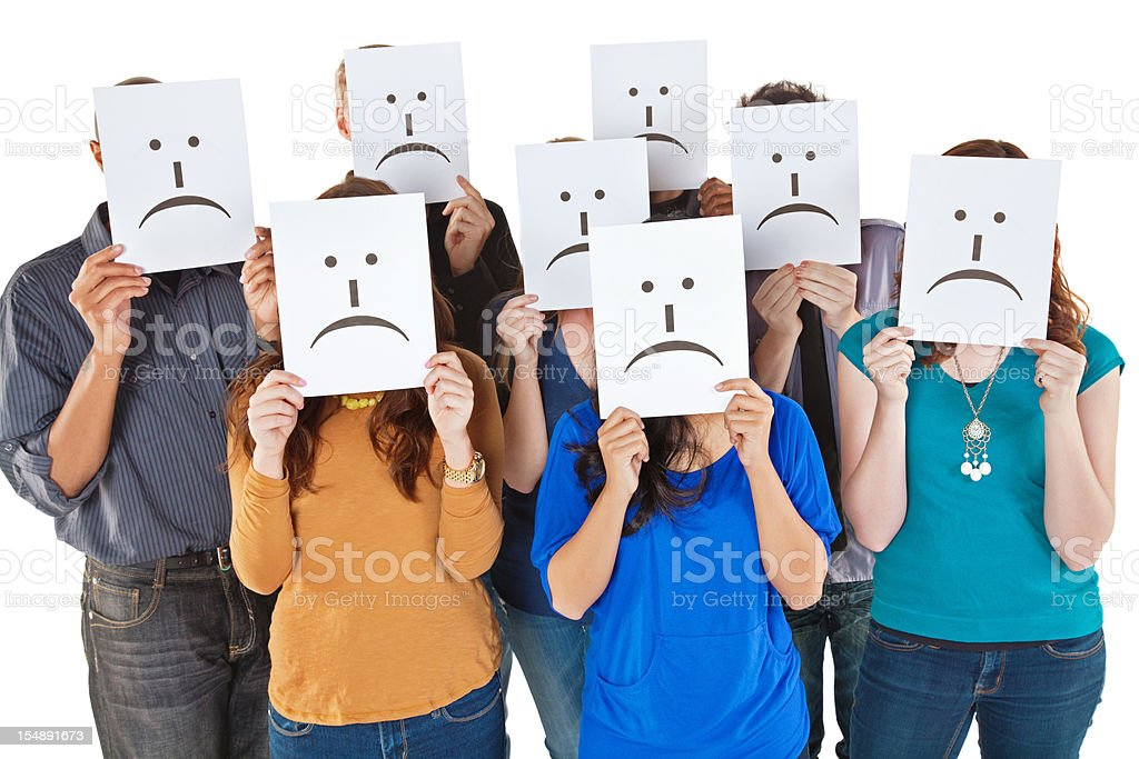 Group of People Holding Sad Face Signs Up stock photo