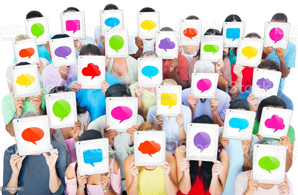 Group of people holding tablets with colored speech bubble royalty-free stock photo