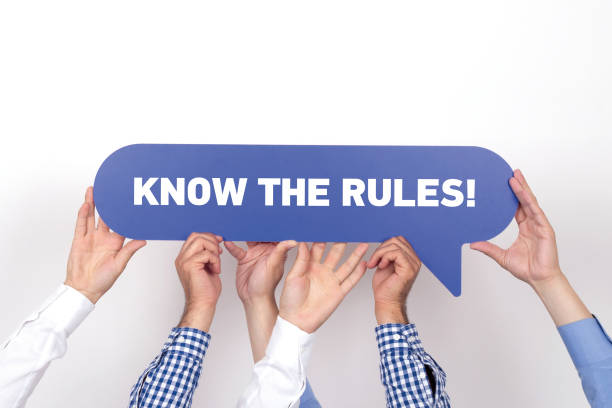 Group of people holding the KNOW THE RULES! written speech bubble Group of people holding the KNOW THE RULES! written speech bubble medical procedure stock pictures, royalty-free photos & images