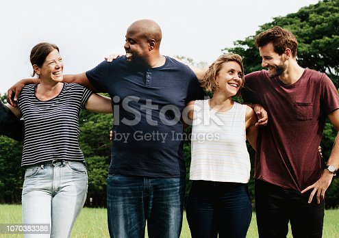 1094812112 istock photo Group of people hugging each other in the park 1070383388