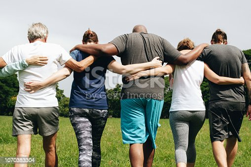 Group of people hugging in the park