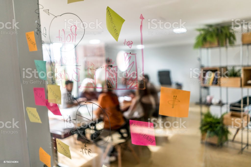 Group of people in a business meeting at a creative office stock photo