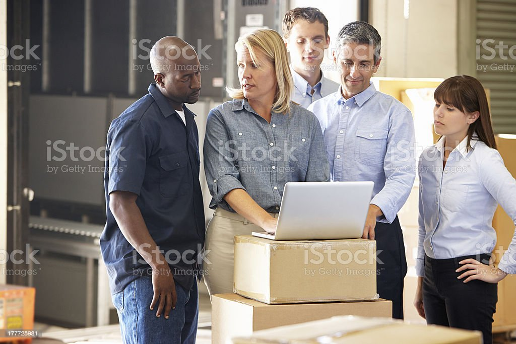 A group of people in a distribution warehouse stock photo