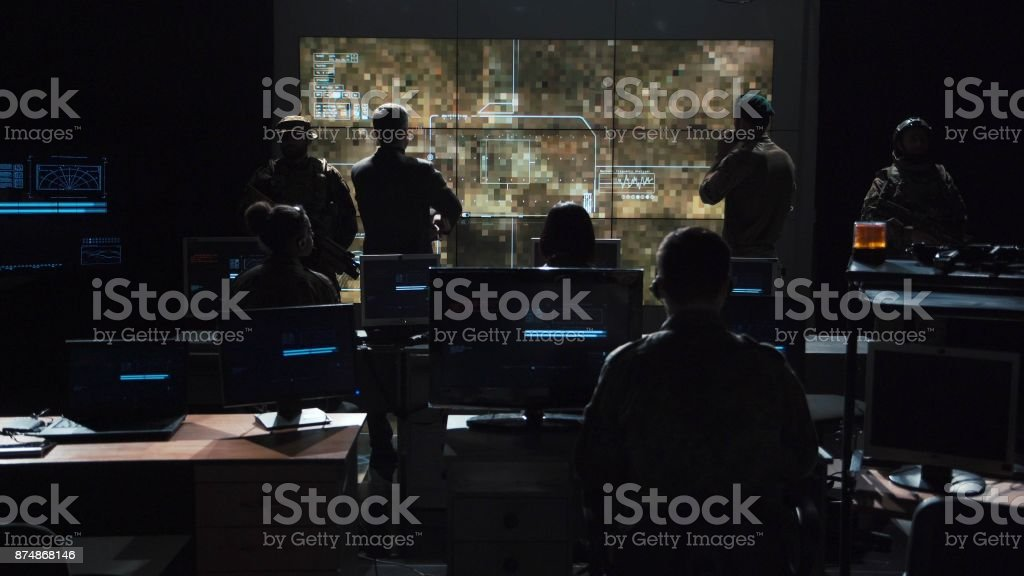 Group of people in dark room launching a missle stock photo