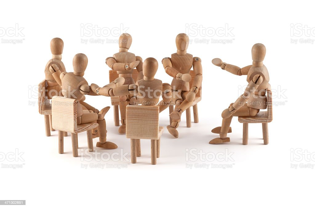 group of people in disput - wooden mannequins stock photo