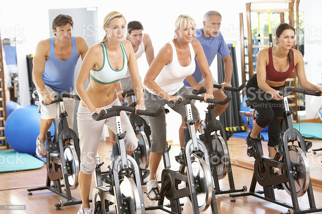 Group Of People In Spinning Class At Gym stock photo