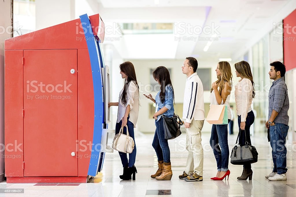 Group of people in line for the ATM stock photo