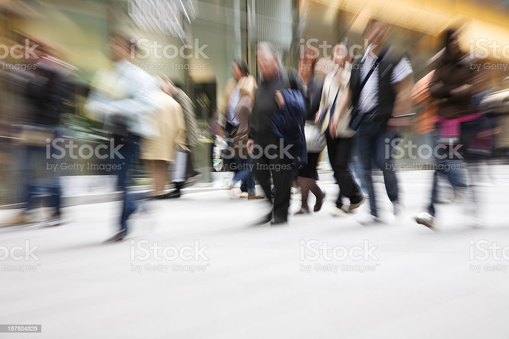 A group of people in motion depicting a typical day in city stock photo