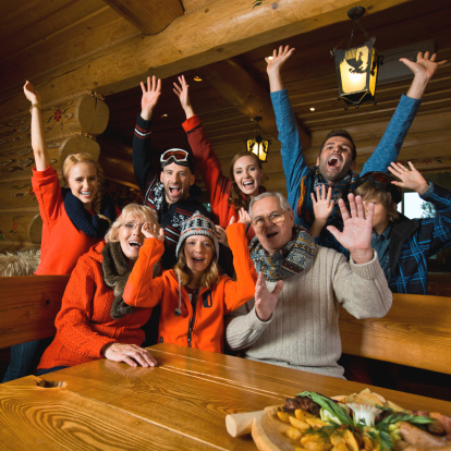 Group Of People In Mountain Restaurant Stock Photo - Download Image Now