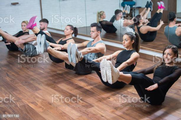 Group of people in sportswear doing abdominal strength exercises in picture id927931130?b=1&k=6&m=927931130&s=612x612&h=scuakm2qhiug5wcpnkyizc4foucefwwa6e4n5djrefe=
