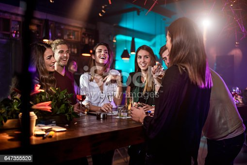 istock Group of people in the bar 647355520