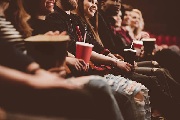 Group of people in the cinema stock photo