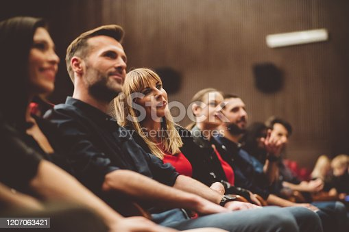 483876497 istock photo Group of people in the movie theater 1207063421