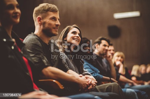 483876497 istock photo Group of people in the movie theater 1207064374