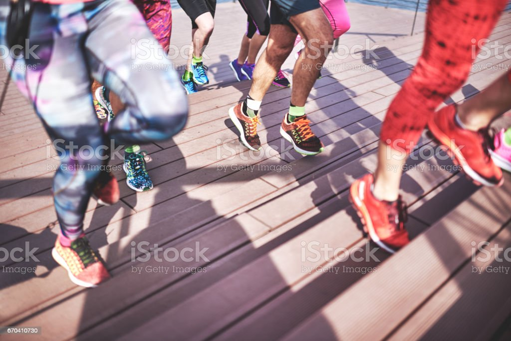 Group of people jogging stock photo