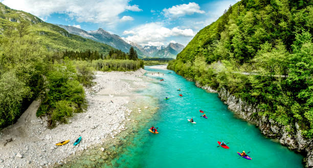 Group of people kayaking on the river Soča in Slovenia Europe stock photo