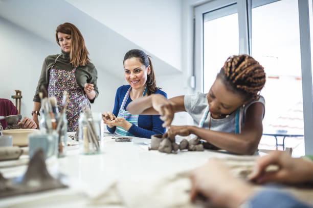 Group of people learning ceramic art. stock photo