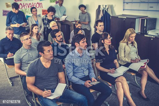 603992132 istock photo Group of people listening and taking notes on a seminar 610762378