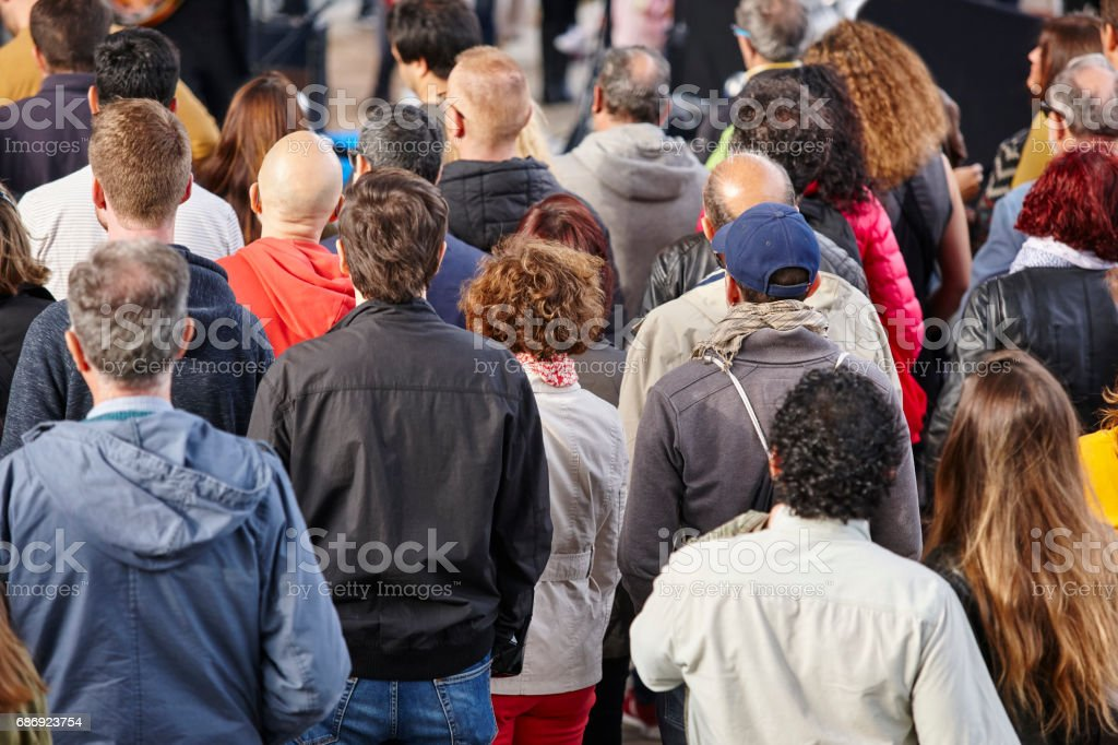Group of people listening on the street. Crowded background stock photo