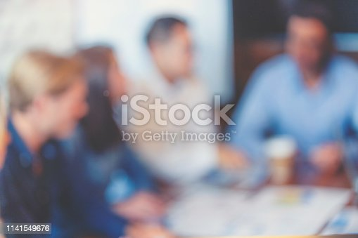 618851838 istock photo Group of people listening to a presentation. Defocussed. 1141549676