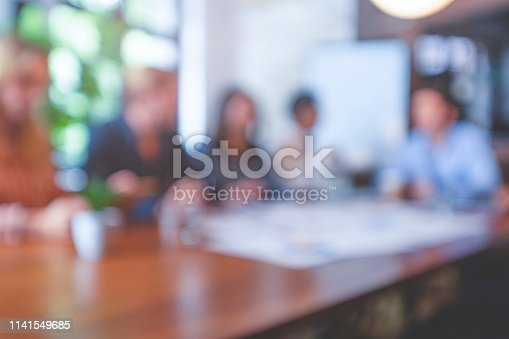 618851838 istock photo Group of people listening to a presentation. Defocussed. 1141549685