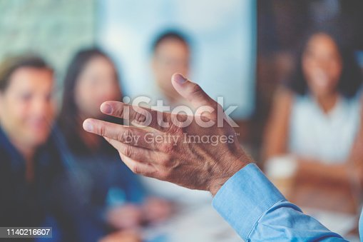 892254154 istock photo Group of people listening to a presentation. Defocussed with focus on foreground. 1140216607