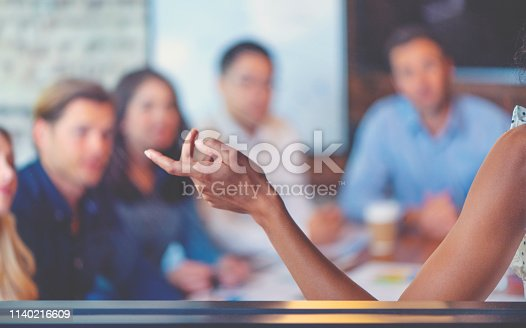 istock Group of people listening to a presentation. Defocussed with focus on foreground. 1140216609
