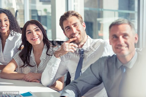 640177838 istock photo Group of people listening to a presentation. 841015398