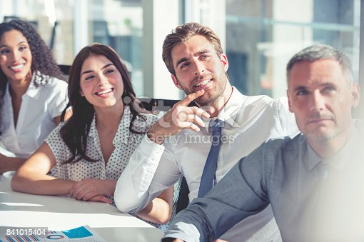 640177838 istock photo Group of people listening to a presentation. 841015404