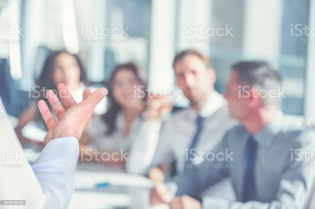 Group of people listening to a presentation. stock photo