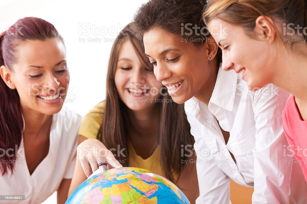 Group Of People Looking At Globe In The Classroom royalty-free stock photo