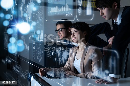 istock Group of people looking at the futuristic user interface. 952984974