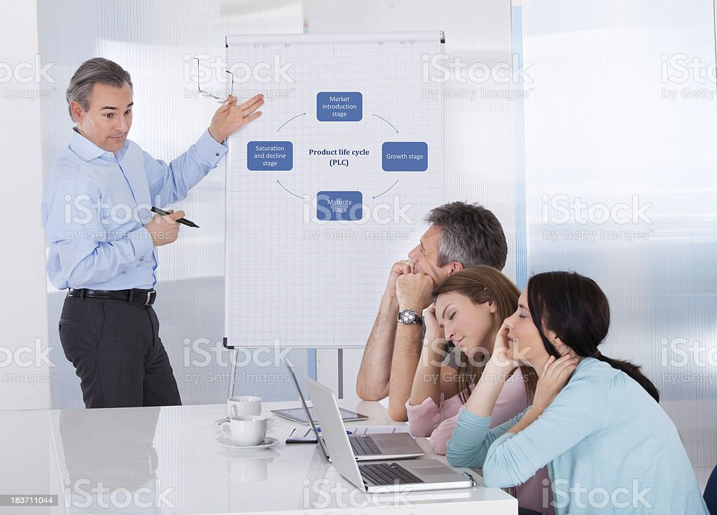 A group of people looking bored at a business presentation stock photo