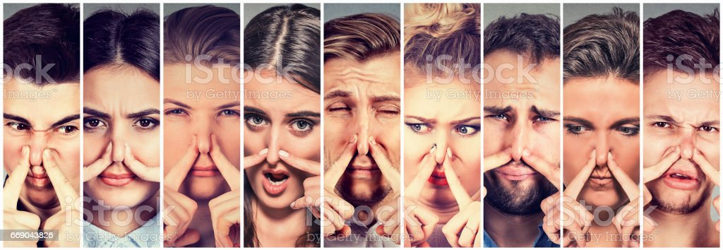 Group of people men and women pinching nose, bad smells stock photo