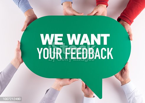 1130633985 istock photo Group of People Message Talking Communication WE WANT YOUR FEEDBACK Concept 1007212490