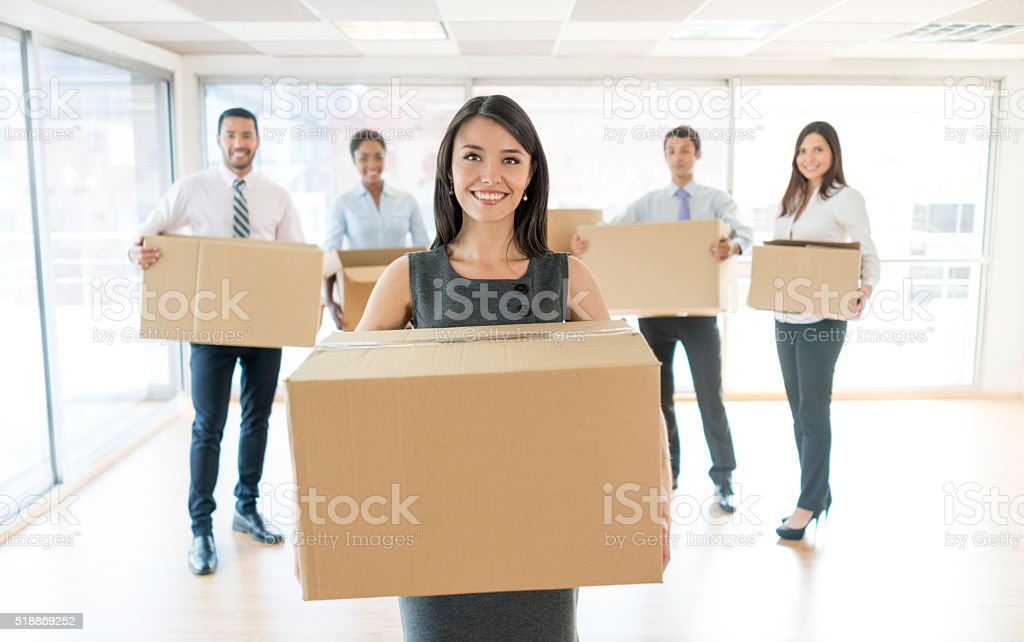 Group of people moving to a new office stock photo