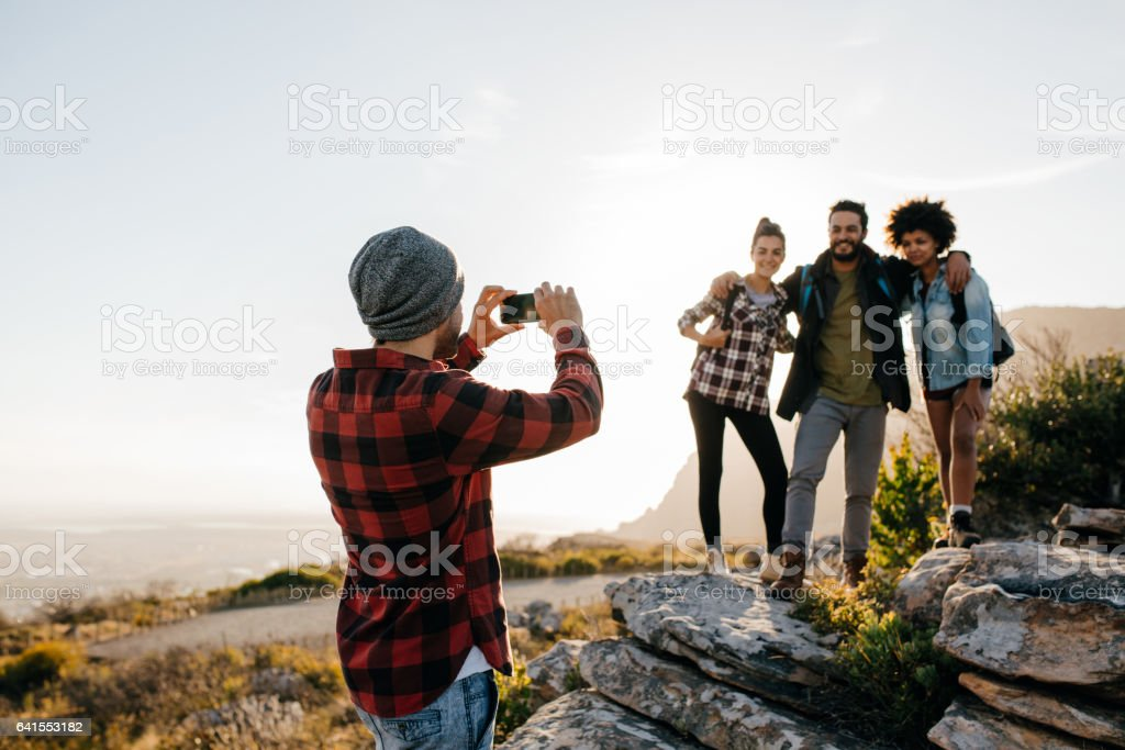 Group of people on hiking taking photographs stock photo