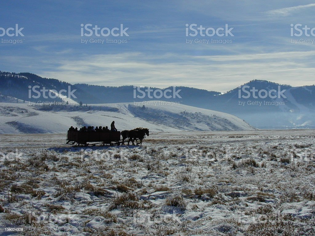 Group of People on Hourse Sleigh Against Winter Landscape stock photo