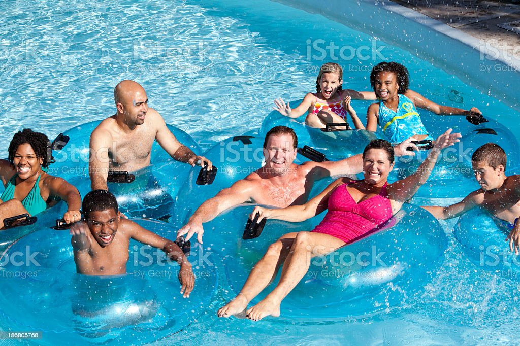 Group of people on innertubes at water park royalty-free stock photo