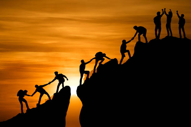Group of people on peak mountain climbing helping team work , travel trekking success business concept Group of people on peak mountain climbing helping team work , travel trekking success business concept win stock pictures, royalty-free photos & images