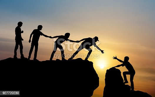 istock Group of people on peak mountain climbing helping team work , travel trekking success business concept 927720230