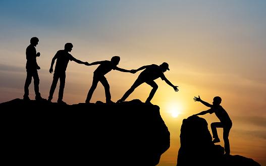 istock Group of people on peak mountain climbing helping team work , travel trekking success business concept 927720230