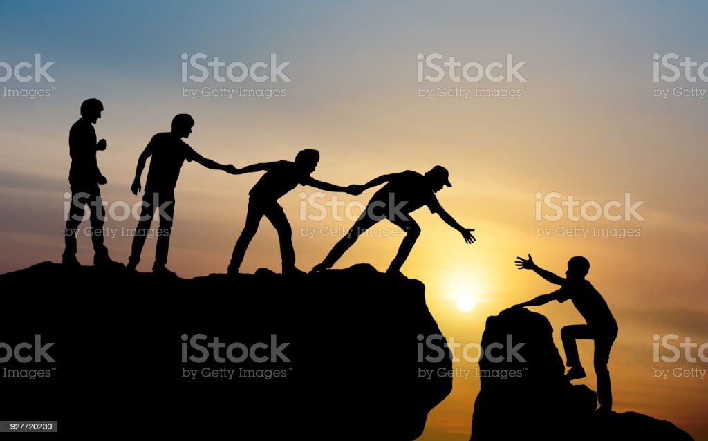 Group of people on peak mountain climbing helping team work , travel trekking success business concept - foto stock