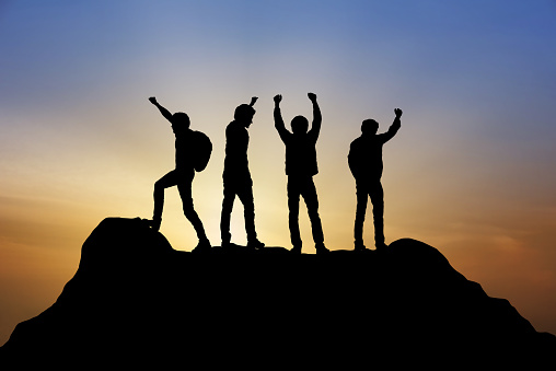 istock Group of people on peak mountain climbing helping team work with sunset background , travel trekking success business  winner concept 1126360217